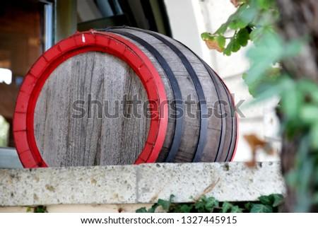 Wine barrel with acacia tree bark with green ivy leaf, Tokaji, Hungary #1327445915