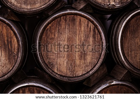 Wine barrels, close up. Wine casks at the winery. Stacked old Wine barrels at the german winery.