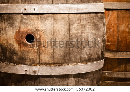 Wine Barrels in Dark Cellar