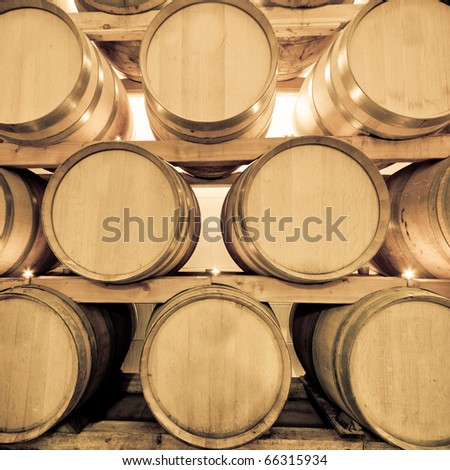 wine barrels in old wine cave - stock photo