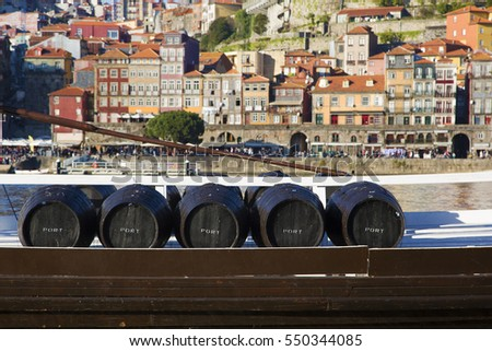 wine barrels in porto. five...
