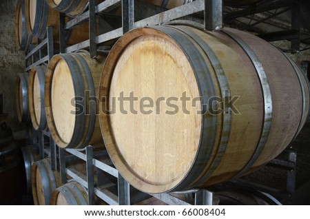 Wine barrels in storage at a winery in the Adelaide Hills, South Australia.