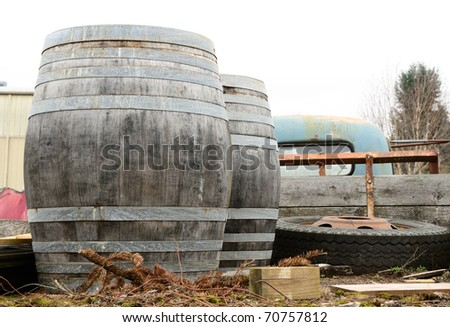 Wine barrels in the back of an old truck outside a farmers market in McMinnville Oregon