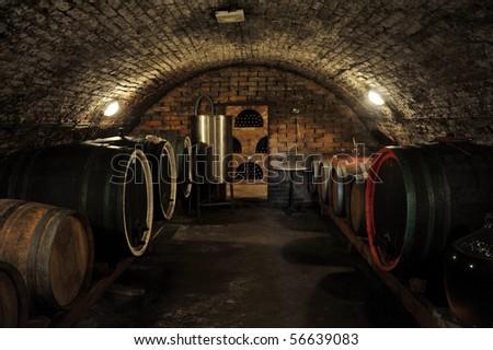 Wine barrels in traditional wine cellar