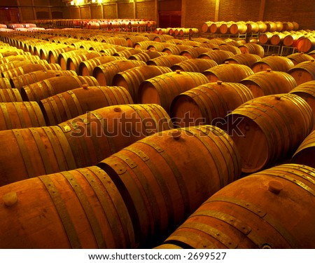 wine barrels in wineyard cellar - stock photo