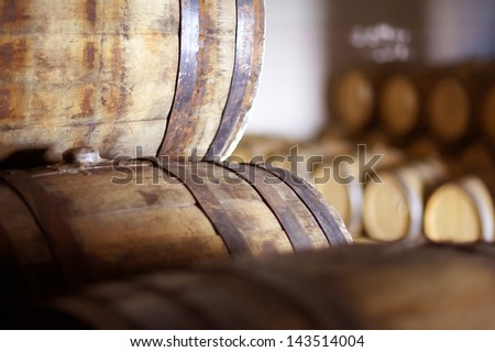 Wine barrels stacked in the old cellar of the winery. Imagine de stoc ©