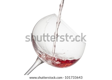 Wine being poured into a glass includes clipping path