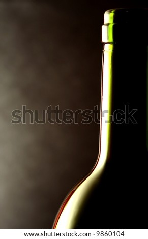 wine bottle against a black background