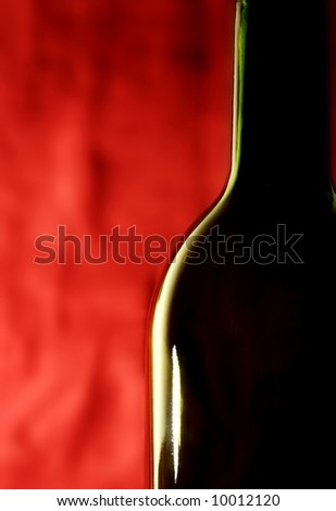 wine bottle against a red background