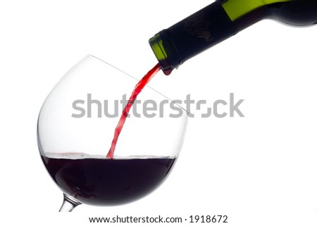 Wine bottle and a wine glass against white background