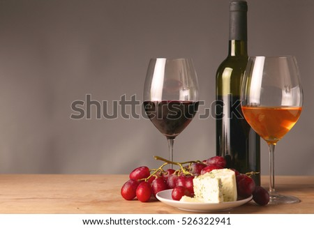 wine bottle and glass on a table #526322941