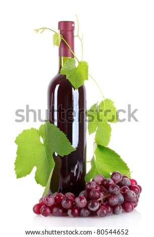 Wine bottle and grapes isolated on white