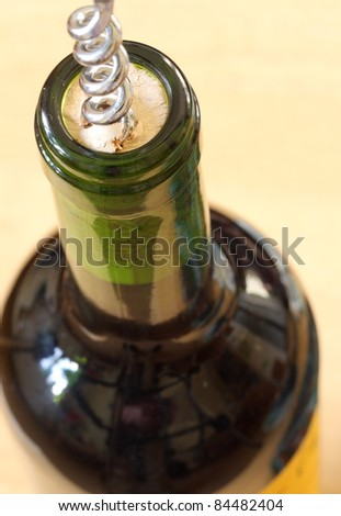 Wine bottle being opened with a corkscrew. (Shallow depth of field)