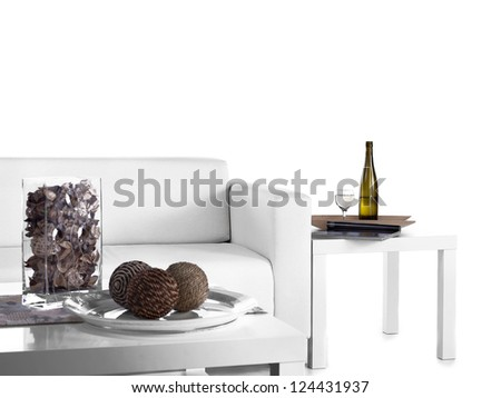 Wine bottle in living room beside couch.