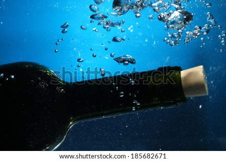 wine bottle neck on water with bubbles