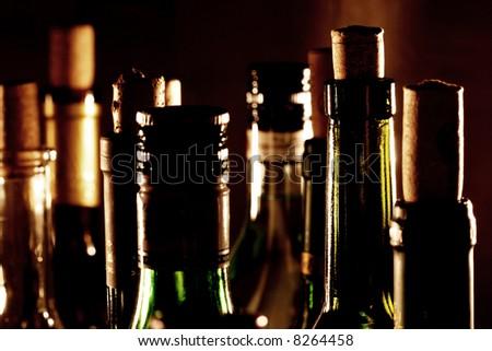 Wine bottle necks. Different wine bottles with cork.