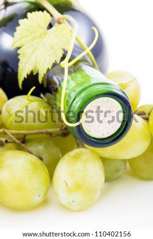 Wine bottle of grape leaves and grapes.