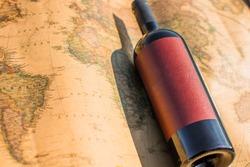 Wine bottle on world map background