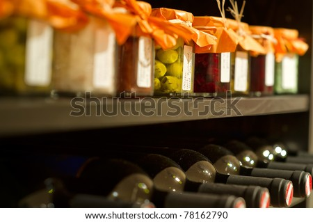 Wine bottles and mason jars in a shelf