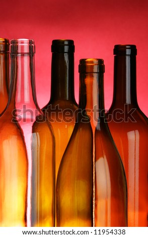 Wine bottles close-up over red background