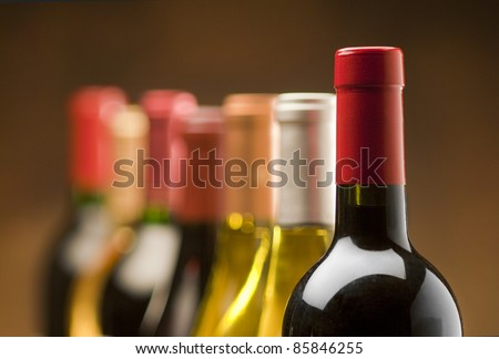 Wine bottles in a row with limited depth of field