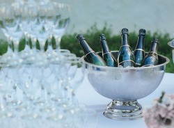 Wine bottles in silver cold ice bucket