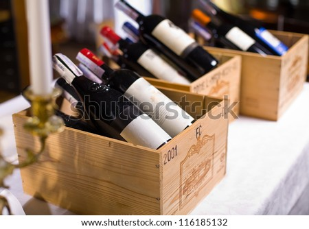 Wine bottles in wooden boxes are on the table restaurant. Wine background. #116185132