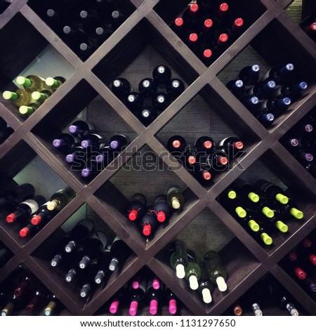 Wine bottles on the shelves #1131297650