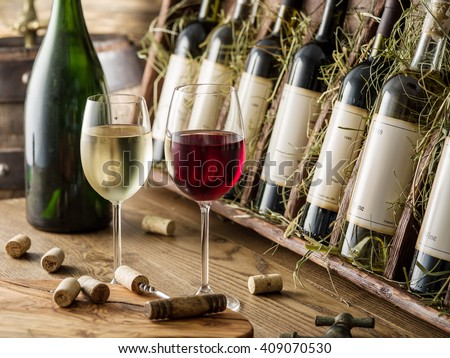 Wine bottles on the wooden shelf. Wine cellar.