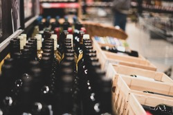Wine Bottles. Selective focus. Wine storage. Showcase with wine. Presentation of wine in the trade