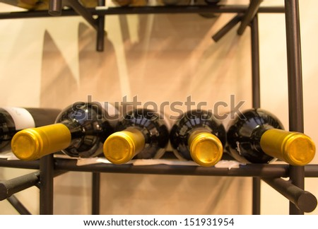 Wine bottles stacked on racks shot with limited depth of field
