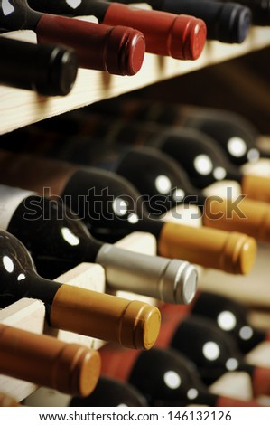 Wine bottles stored in a shelf very shallow DoF