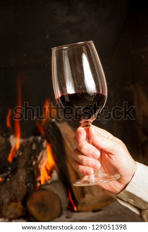 Wine by the fireplace, glasses of wine.