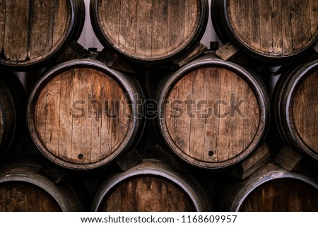 Wine casks at the winery. Stacked Wine barrels at the german winery. #1168609957