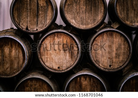 Wine casks at the winery. Stacked Wine barrels at the german winery. #1168701046