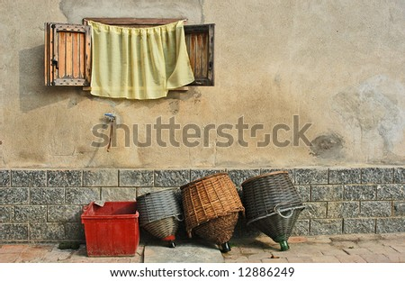 wine casks drying under a curtained window in Italy