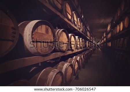 Wine cellar with a row of barrels, Austria