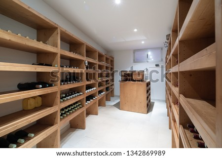 Wine cellar with bottles and cigar humidifier. Nobody inside