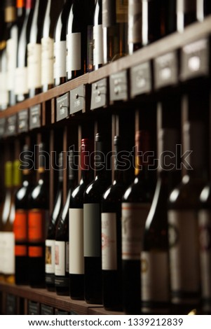 Wine cellar with elite drinks on shelves with written names #1339212839