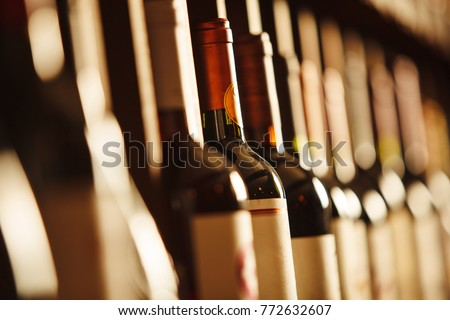 Wine cellar with elite drinks on shelves with written names #772632607