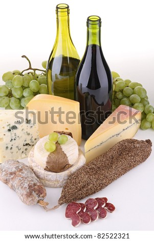 wine, cheese, salami and grape on white background