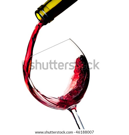 Wine collection - Red wine is poured into a glass from bottle. Close up.