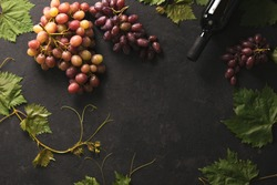 Wine concept, dark wine background with grapes and dark bottle, flat lay, space for a text