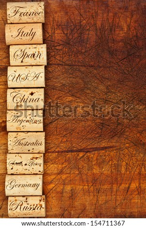Wine cork border with the top ten Wine countries of the world on wooden background