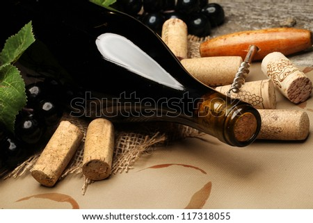 Wine Cork, Corkscrew and red wine stains on the  paper background