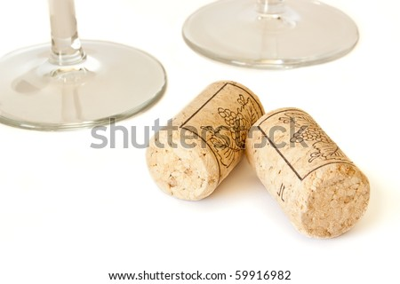Wine cork isolated on white background and two wine glasses