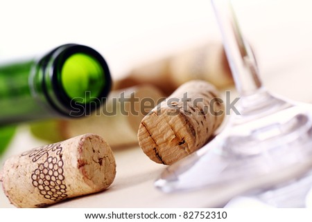 Wine corks, bottle and glass on the table