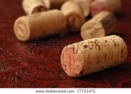 Wine corks on burgundy colored textured leather.  Macro with extremely shallow dof.