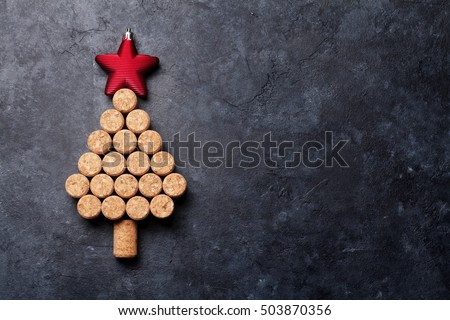 Wine corks shaped christmas tree on stone table. Top view with copy space for your text