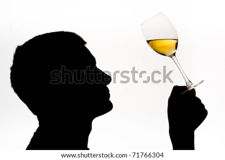 Wine expert testing wine with male in silhouette